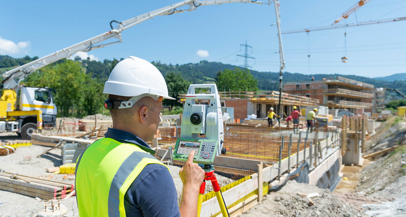 Leica TS16 robotic total station used on a building construction site
